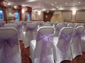 chair covers violet sashes